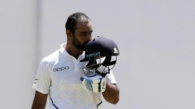 India's Hanuma Vihari celebrates after he scored a century against West Indies during day two of the second Test cricket(AP)