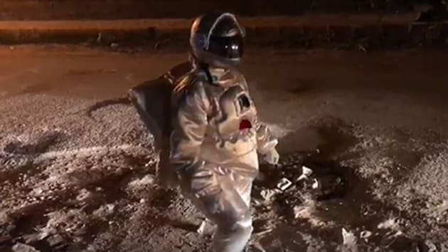 India's IT capital woke up on Monday to a viral video of an astronaut negotiating a crater on a Bengaluru road like it were a crater on the moon.(Badal Nanjundswamy/Facebook)