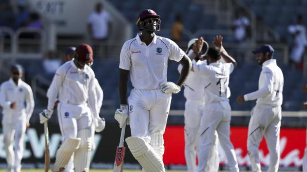 West Indies' captain Jason Holder looks up as players of India celebrate the dismissal of Shimron Hetmyer(AP)