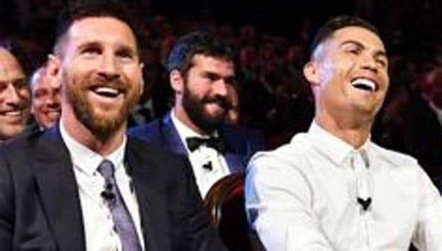 Cristiano Ronaldo of Juventus and Lionel Messi of FC Barcelona (L to R).(UEFA via Getty Images)