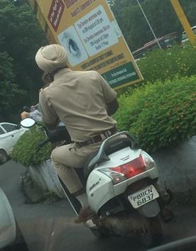 A Twitter user posted this image of the cop violating traffic rules.(HT photo)