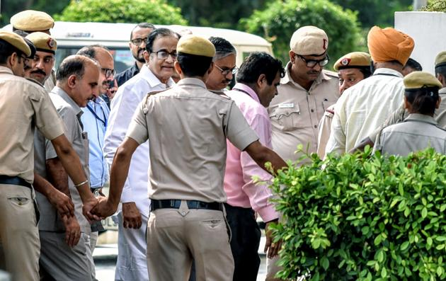 CBI Officials arrive with P. Chidambaram at Rouse Avenue District Court Complex in New Delhi, on Thursday.(ANI Photo)
