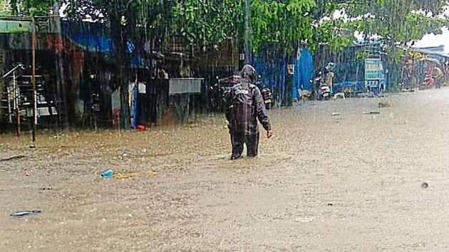 Wednesday's incessant rain submerged Dungi village. The project-hit people have refused to shift.(HT Photo)