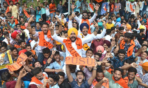 Panjab University Student Union alliance presidential candidate Gurjinder Singh celebrating his victory with his supporters at Post Graduate Government College, Sector 11, in Chandigarh on Friday.(Anil Dayal/HT)