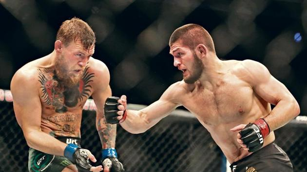 Khabib Nurmagomedov (R) defeated Conor McGregor in the UFC Lightweight title fight in October 2018 but a ringside brawl resulted in his suspension. Khabib will return to the cage for his second title defense against American Dustin Poirier on Saturday(getty images)
