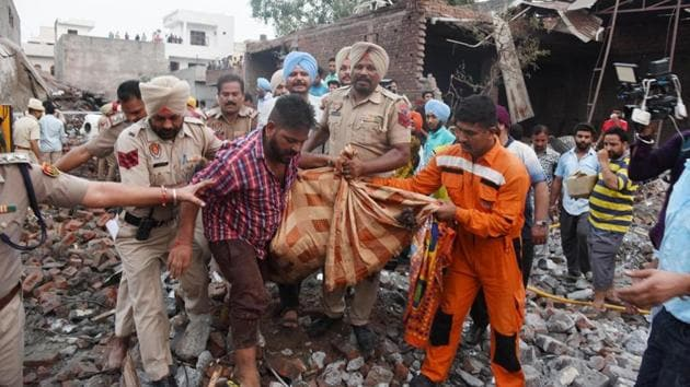 A day after the blast at a firecracker-manufacturing unit in Batala that killed 23 people and injured 27, police on Thursday said the unit was running illegally from the residential area as its licence had expired in 2016. . (Photo by Sameer Sehgal/ Hindustan Times )