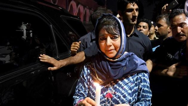 Former Chief Minister of Jammu and Kashmir and PDP leader Mehbooba Mufti during a candle march protest in Srinagar on August 4, a day before she was detained by the Centre.(ANI Photo)