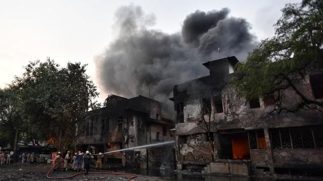 New Delhi, India-September 07, 2019: Firefighters douse the fire in an oil Godown, at Punjabi Bagh, in New Delhi, India, on Saturday, September 07, 2019. A fire broke out at a godown in west Delhi's Punjabi Bagh area at 4:57pm. (Photo by Sanchit Khanna / Hindustan Times)