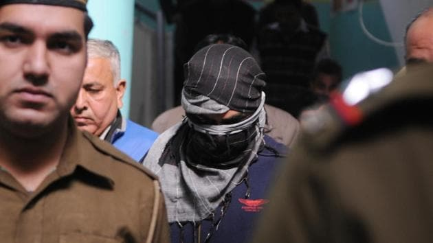 The CBI produces a Class 11 student (Face Covered) in Pradyuman Thakur murder case of Ryan International School in (Juvenile Justice Board) JJB. 16 year old juvenile accused will be treated as an adult; the juvenile justice board pronounced the order, in Gurgaon, India, on Wednesday, 20 December 2017. ( Photo by/Hindustan Times)(Parveen Kumar/ HT Photo)