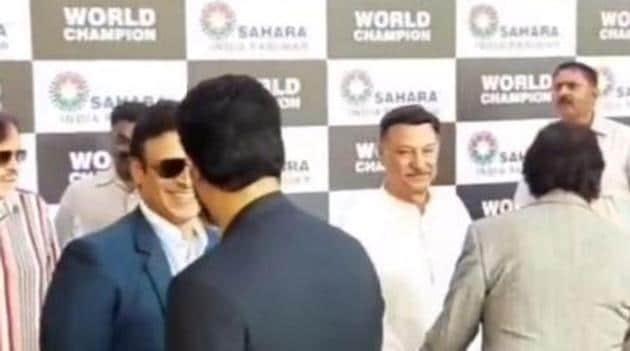 Vivek Oberoi and Abhishek Bachchan greet each other at PV Sindhu's felicitation event.