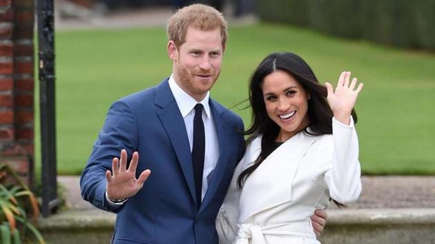 Prince Harry with Meghan Markle((REUTERS/Eddie Mulholland))