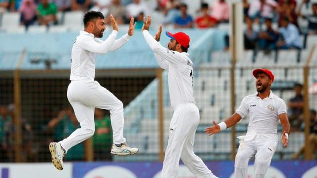 Afghanistan captain Rashid Khan celebrates after picking up a wicket against Bangladesh in the one off Test at Chattogram.(Twitter/ICC)