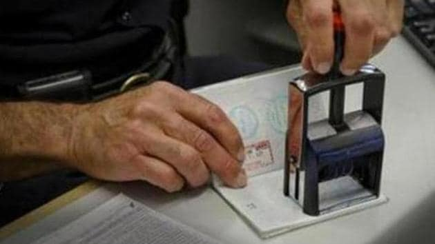 A passport is stamped at the immigration security check in Newark, New Jersey. The change will ensure that hospitals and medical practices across the UK will be able to access the staff they need more quickly, the Home Office said.(File photo: NYT)