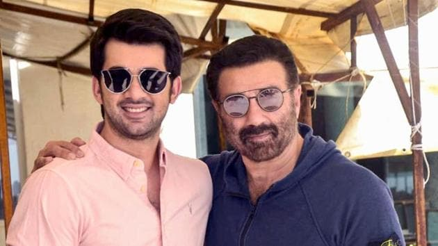 Sunny Deol and actor Karan Deol pose for photographs during promotion of their upcoming film Pal Pal Dil Ke Paas in Mumbai.(PTI)