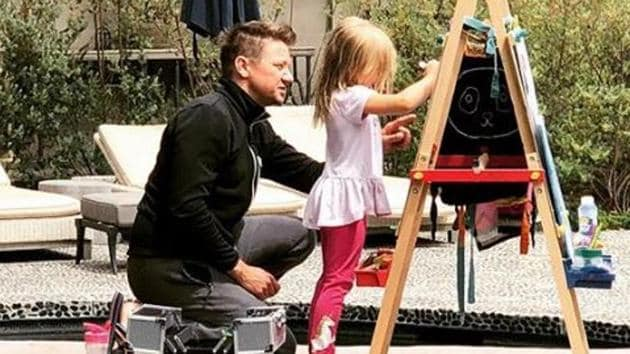 Jeremy Renner draws with his daughter, Ava, whose face he keeps hidden on social media.