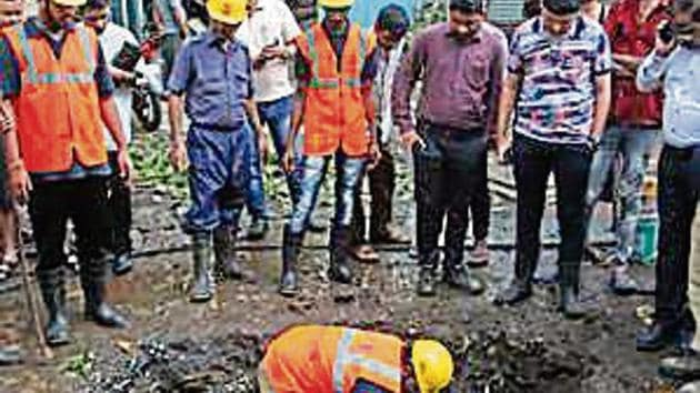 """Santosh Kadam, chief of Regional Disaster Management Cell (RDMC), said, """"A tree had fallen on a road in the commercial area of Panchpakhadi.(HT image)"""