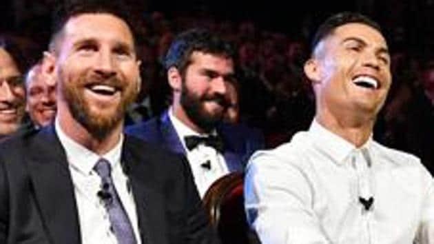 A file photo of Lionel Messi (L) and Cristiano Ronaldo.(UEFA via Getty Images)