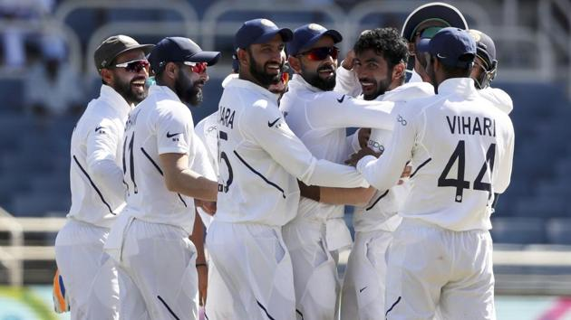 India's Jasprit Bumrah is congratulated by teammates for his hat-trick wicket.(AP)