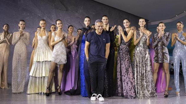 Designer Naeem Khan takes a bow after his collection was modeled during Fashion Week, Tuesday, Sept. 10, 2019, in New York. (AP Photo/Mary Altaffer)(AP)