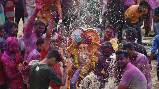 """Devotees in a procession of lords Ganesh """" to immerse idols of elephant-headed Hindu god Ganesha in the temporary water pond made by Delhi Government at Geeta Colony in New Delhi, India, on Thursday, September 12, 2019. marking the end of the 10-day long Ganesh Chaturthi festival.(Raj K Raj/ Hindustan Times)"""