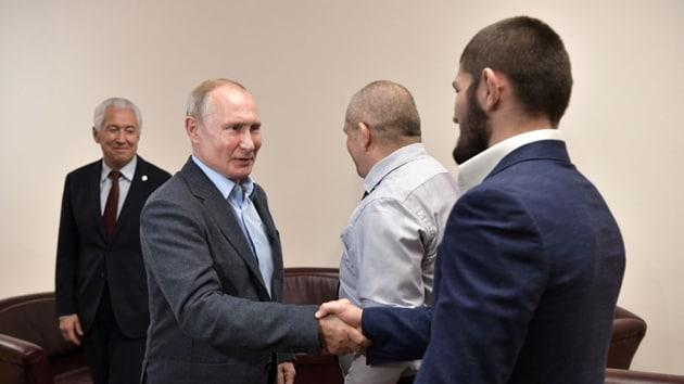 Russian President Vladimir Putin shakes hand with Khabib Nurmagomedov.(@EmbassyofRussia)