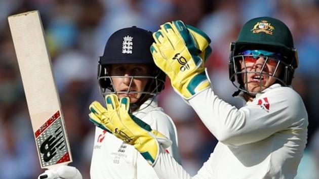 File image of England captain Joe Root and Australia skipper Tim Paine (R).(Action Images via Reuters)