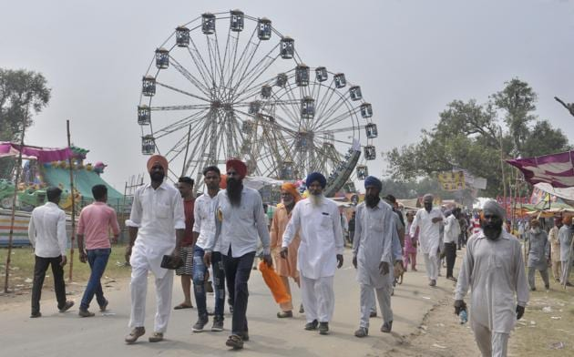 Visitors on the first day of Chappar Mela in Ludhiana on Friday.(Gurminder Singh/HT)