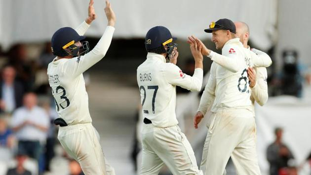 England's Joe Root celebrates with teammates after taking a catch to dismiss Australia's Josh Hazlewood.(Action Images via Reuters)