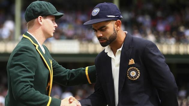 Steve Smith of Australia shakes hands with Virat Kohli of India.(Cricket Australia via Getty Imag)