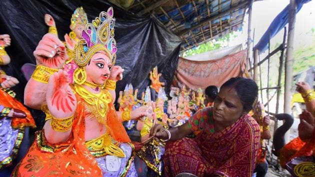 Nagoan: An artist gives final touches to an idol of Lord Vishwakarma at a workshop ahead of upcoming Vishwakarma Puja Festival in Nagaon district of Assam, Saturday, Sept. 14, 2019.(PTI)