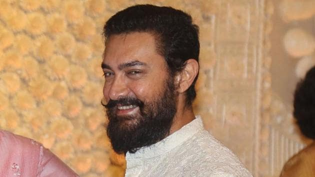 Aamir Khan at the Ganesh Chaturthi celebrations at Mukesh Ambani's residence Antilla in Mumbai.(PTI)