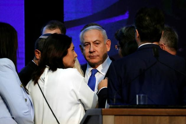 Israeli Prime Minister Benjamin Netanyahu looks on after speaking to supporters at his Likud party headquarters following the announcement of exit polls during Israel's parliamentary election in Tel Aviv.(REUTERS)