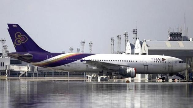 In December 2013, when the couple reached the airport, Thai Airways gave them boarding passes for their journey to Bangkok, but refused to give them boarding passes from Bangkok to Auckland.(AP PHOTO.)