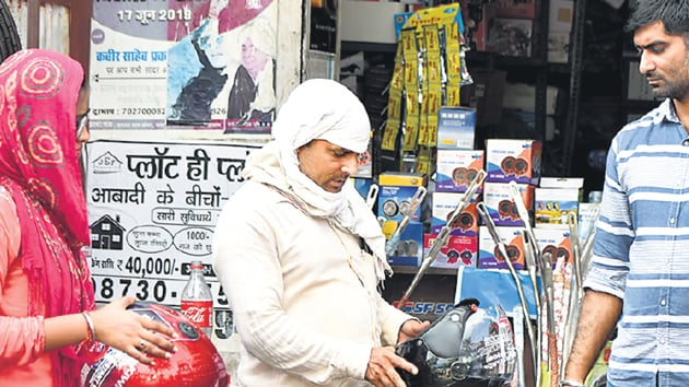 Commuters rush to purchase helmets, sellers in short supply