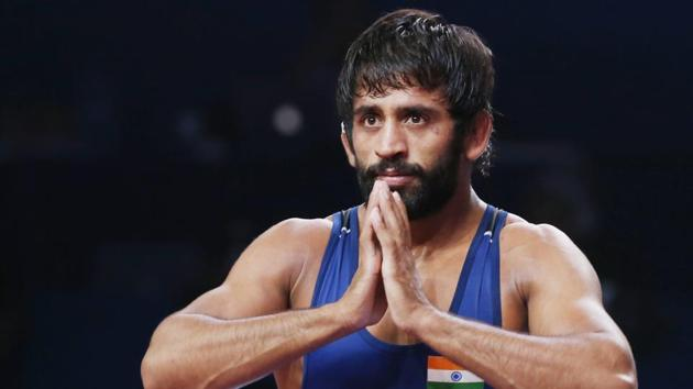 Bajrang Punia of India reacts as he won the bronze match of the men's 65kg category.(AP)