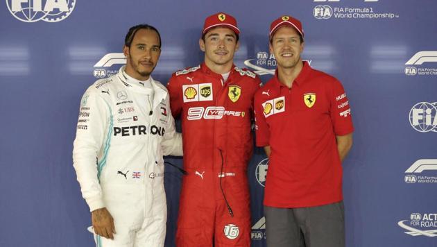 Ferrari driver Charles Leclerc, center, poses with his teammate Sebastian Vettel, right, and Mercedes driver Lewis Hamilton.(AP)