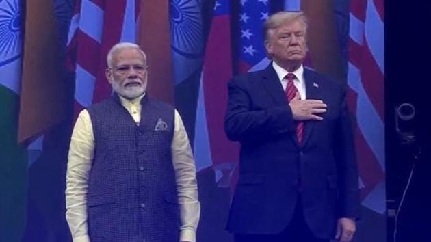 Prime Minister Narendra Modi and US President Donald Trump at Houston's packed NRG stadium on Sunday.(TEXAS INDIA FORUM)