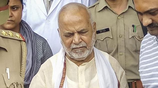 Former Union minister Swami Chinmayanand, accused of rape by a law student, is seen outside a government hospital after a medical examination following his arrest by a special team of Uttar Pradesh police.(PTI)