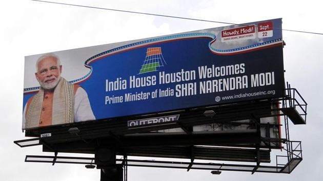 Hoarding of Prime Minister Narendra Modi being placed near NRG Stadium in Houston before his 'Howdy Modi' event.(ANI Photo)