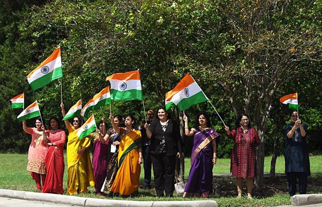 Sun shines as the Indian community holding flags welcomed Prime Minister Narendra Modi on his arrival in Houston on Saturday(ANI Photo)