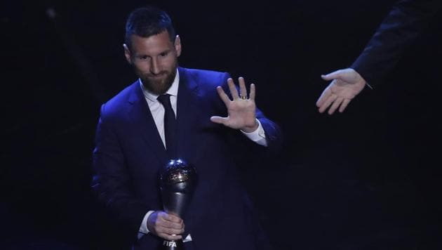 Argentinian Barcelona player Lionel Messi receives the Best FIFA mens player award during the ceremony(AP)