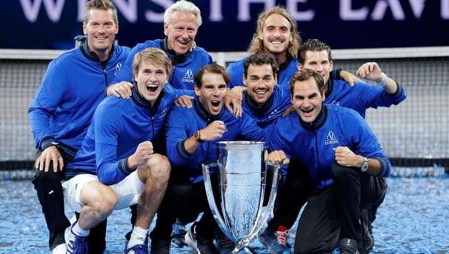 Team Europe captain Bjorn Borg, vice-captain Thomas Enqvist, Alexander Zverev, Dominic Thiem, Fabio Fognini, Stefanos Tsitsipas, Roger Federer and Rafael Nadal pose with the trophy after they win the Laver Cup(REUTERS)