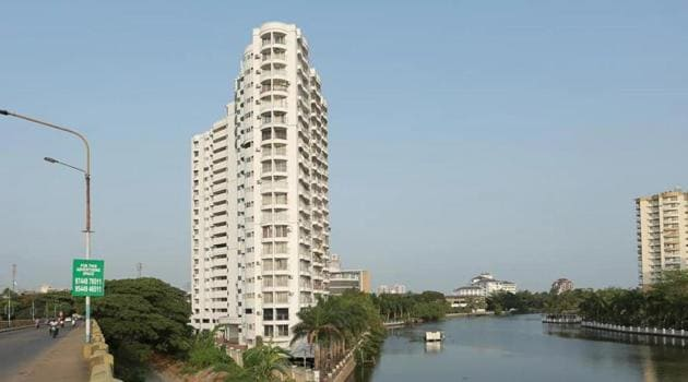 Power supply to four apartment complexes in Kochi that violated coastal regulation zone guidelines has been cut off.(HT Photo)