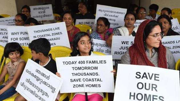 Kochi: Residents of various flats at Maradu, which have been ordered to be demolished by the Supreme Court, stage a protest in front of Holy Faith apartment, in Kochi, Sunday, Sept. 15, 2019. The Supreme Court had on Sept. 6 ordered the demolition of illegal flats in Kochi's Maradu Panchayat by Sept. 20 for violation of Coastal Regulation Zone (CRZ) rules.(PTI)