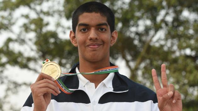 Srihari Natraj poses for photo after he won gold in men 100 metre backstroke swimming.(Pratham Gokhale/HT Photo)