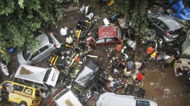 Vehicles are piled up on a street after a flash flood following heavy rains, in Pune.(PTI)