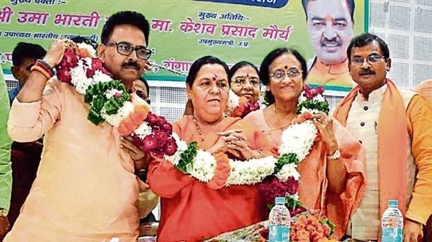 BJP leader Uma Bharti at an event in Prayagraj on Thursday.(HT Photo)