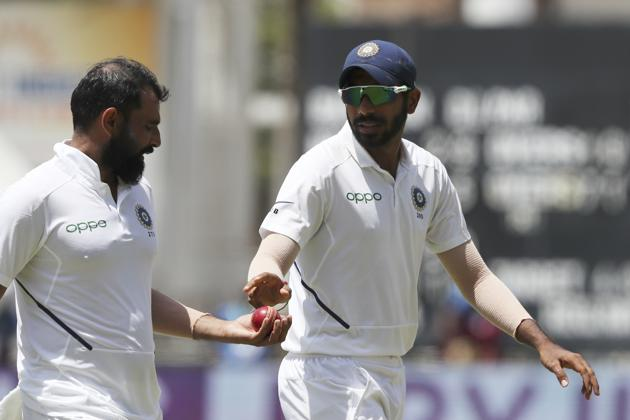 India's Jasprit Bumrah, right, gives the ball to Mohammed Shami(AP)