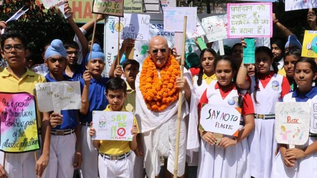 St Joseph's Senior Secondary School students with American Gandhi Bernie Meyer during a march against the use of plastics at Sector 44 market in Chandigarh on Friday.(HT PHOTO)