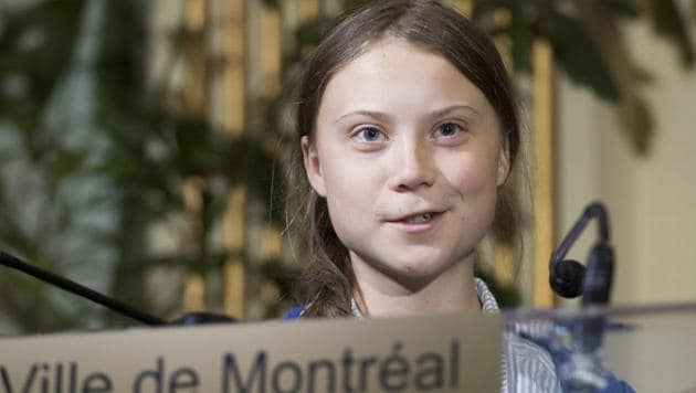 Swedish climate activist Greta Thunberg speaks to reporters after receiving the key to the city of Montreal during a ceremony in Montreal.(AP Photo)